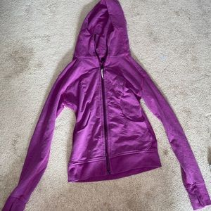 Purple lululemon zip up hoodie.